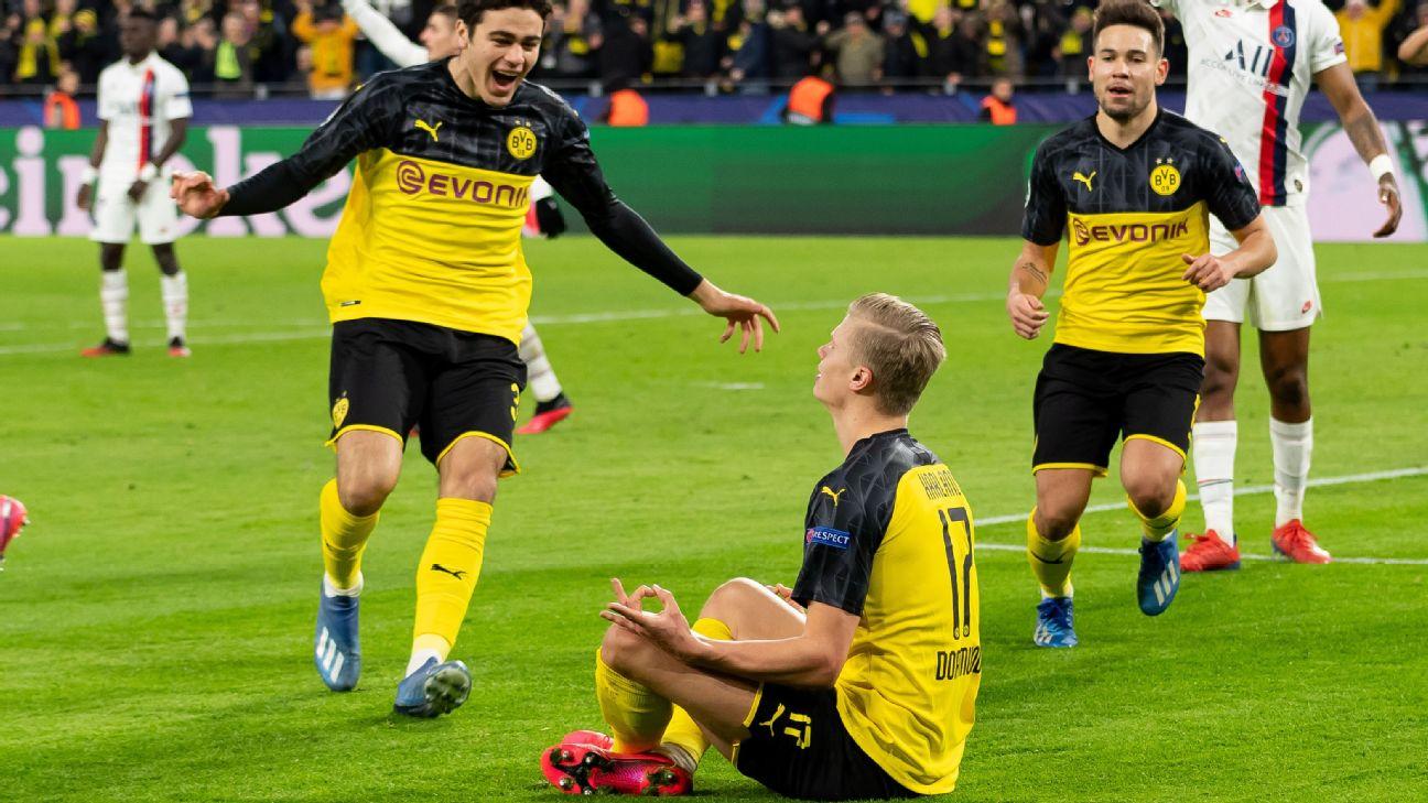 Haaland comemora após marcar para o Borussia Dortmund sobre o PSG